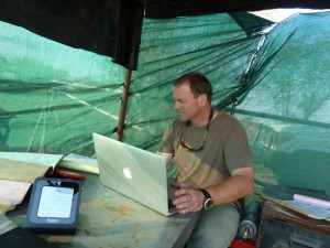 Chris Nelson validating gas data on site in the Kalihari desert, Botswana