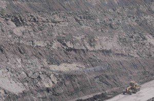 Coal mine high wall in East Kalimantan (Indonesia). Top of Pulaubalang Fm/bottom of Balikpapan Fm. Road grader for scale.
