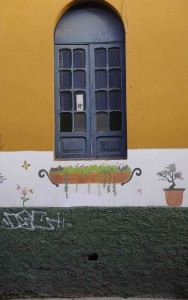 Painted wall and window, Bogotá, Colombia.
