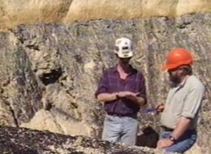 Tim Moore talking to Bill Spicer about ancient peats at the Kaitangata coal mine, South Island, New Zealand (1996).